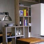 Afscheiding van huiskamer en keuken met open effect